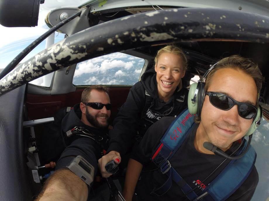 tandem inside skydive pilot airplane plane skydiving customers smiling packages