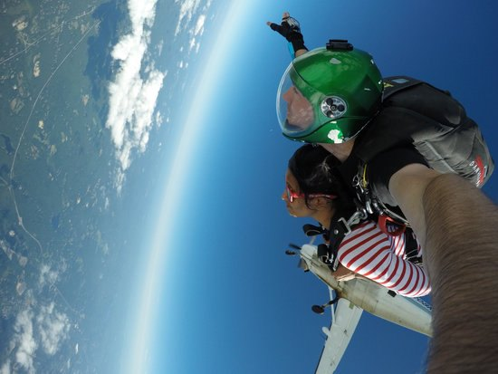 Tandem skydivers in free fall after exiting airplane in CT