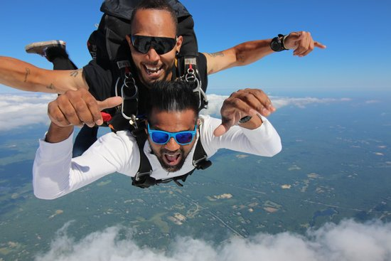 Tandem skydivers in free fall over CT