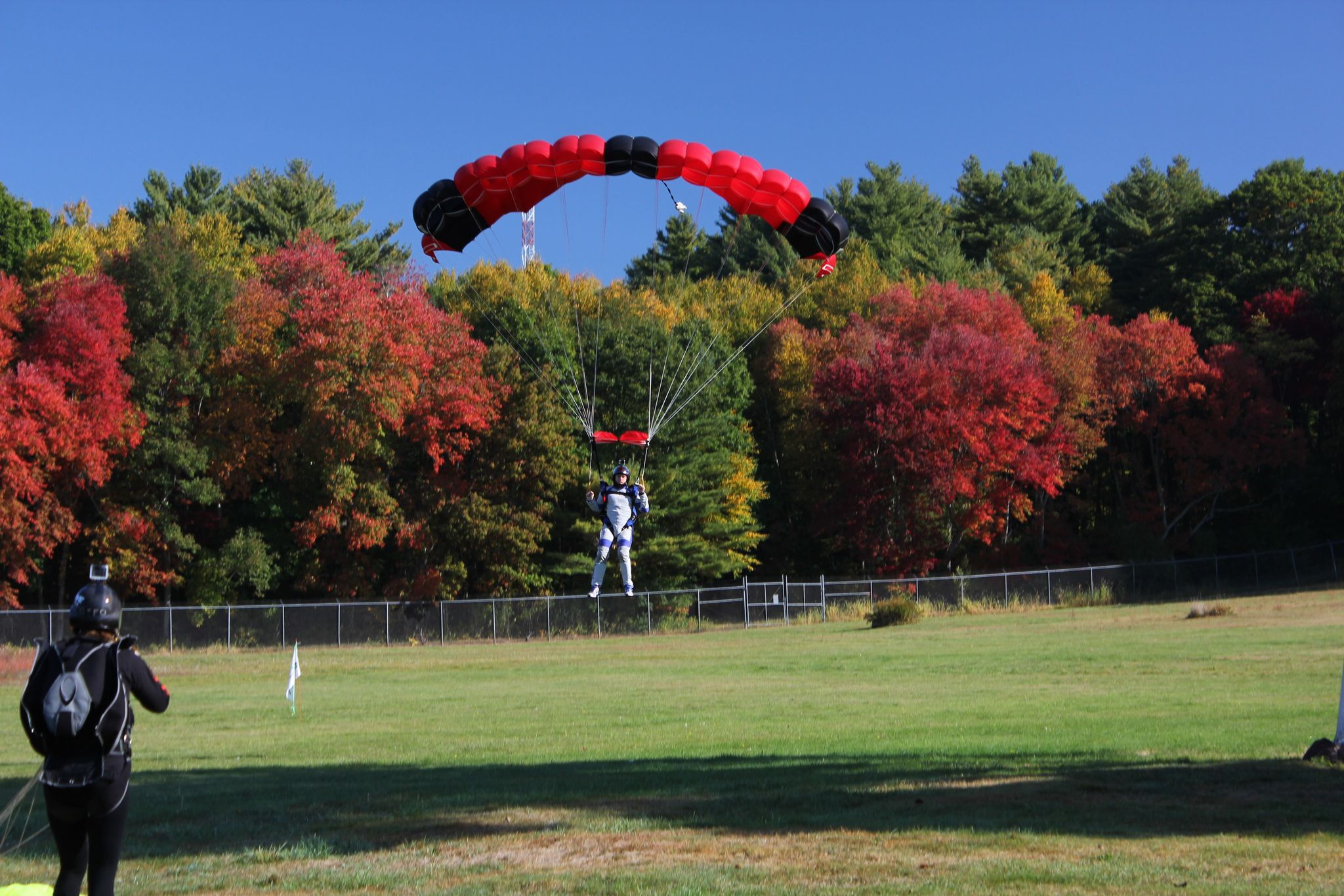 Skydive Parachute landing in the fall folliage of New England