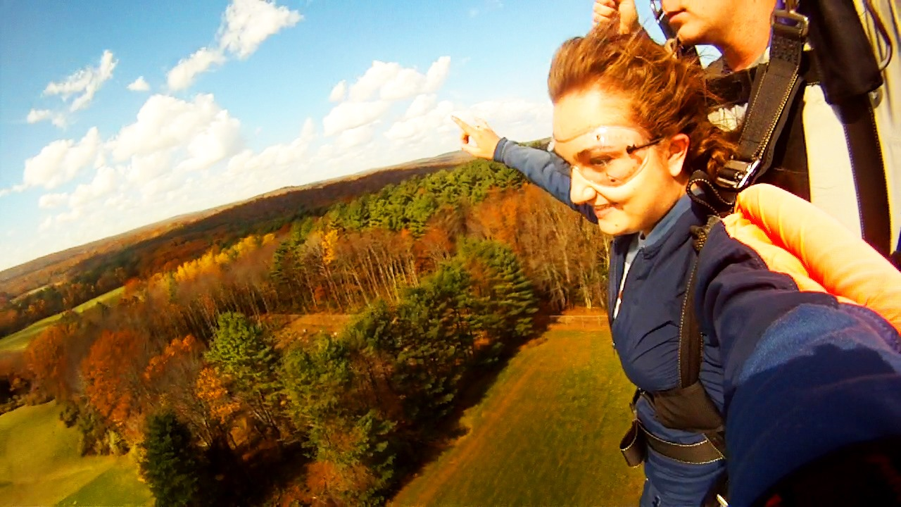 Tandem Skydiver landing a parachute in CT during fall folliage